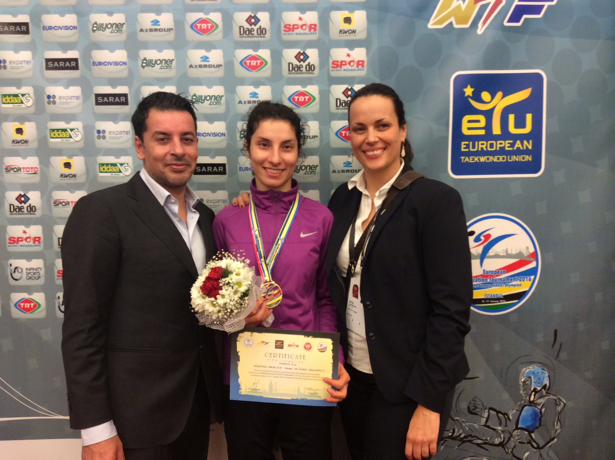 Asemani celebrates with her coach Karim Dighou (left) and performance Director Laurence Rase (right)