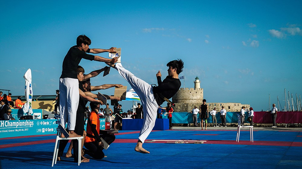 Jong Pil Jang (1st place) performs Spinning Kick Technical Breaking